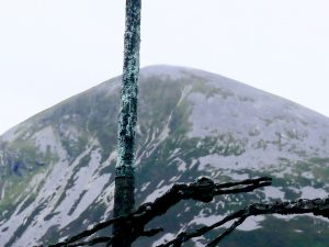 Coffin ship mast against Croagh Patrick